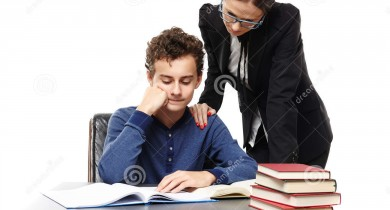 teacher-standing-next-to-student-s-desk-hand-his-shoulde-studio-shot-shoulder-looking-homework-isolated-over-white-36547092